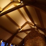 Vaulted ceiling wooden beams with lighting by Sam Coles Lighting