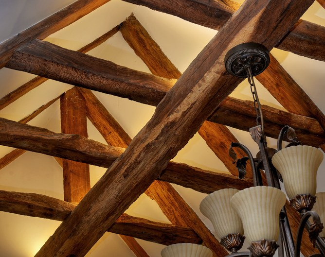 Light fixed to roof beams