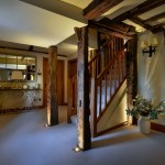 Hallway with groundlights illuminating wooden column