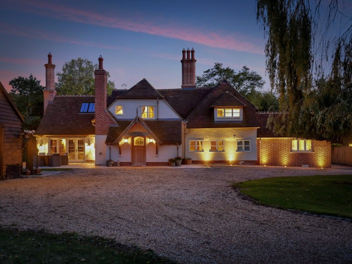 Essex Listed Farmhouse at night with lighting