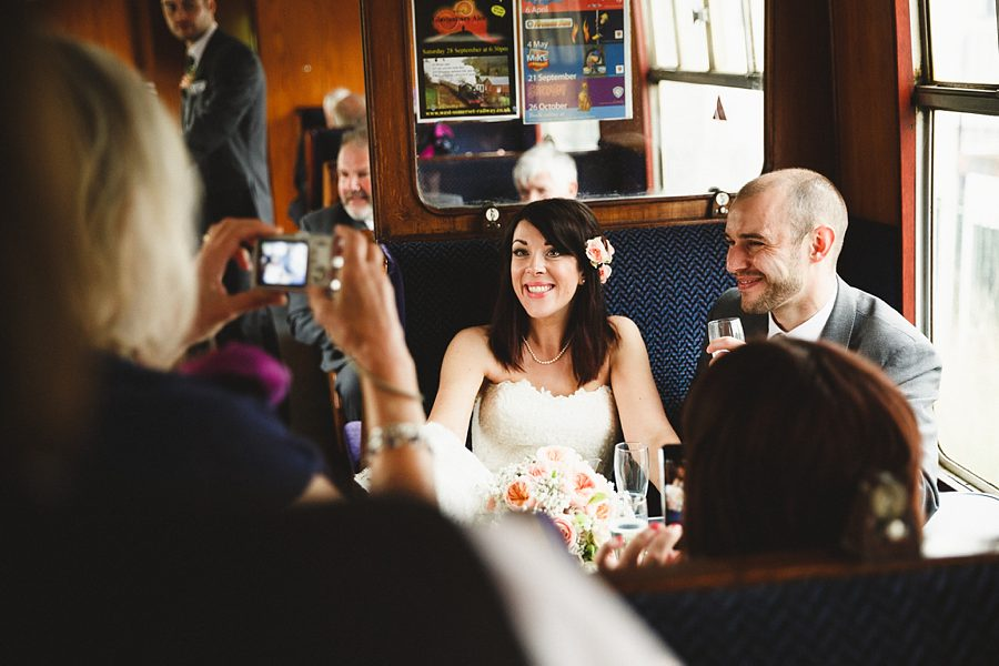 bride and groom on a steam train by sam gibson