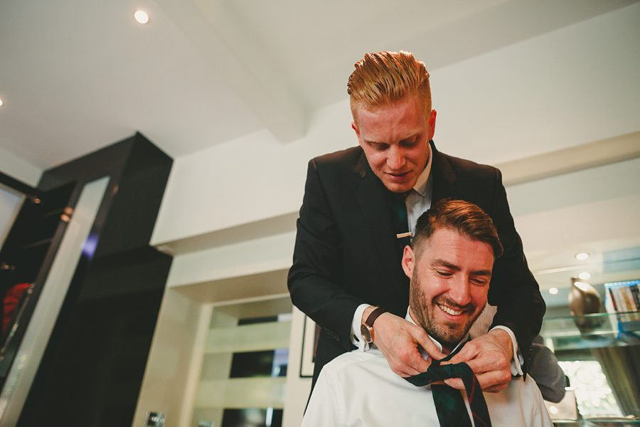 groom needs help with his tie