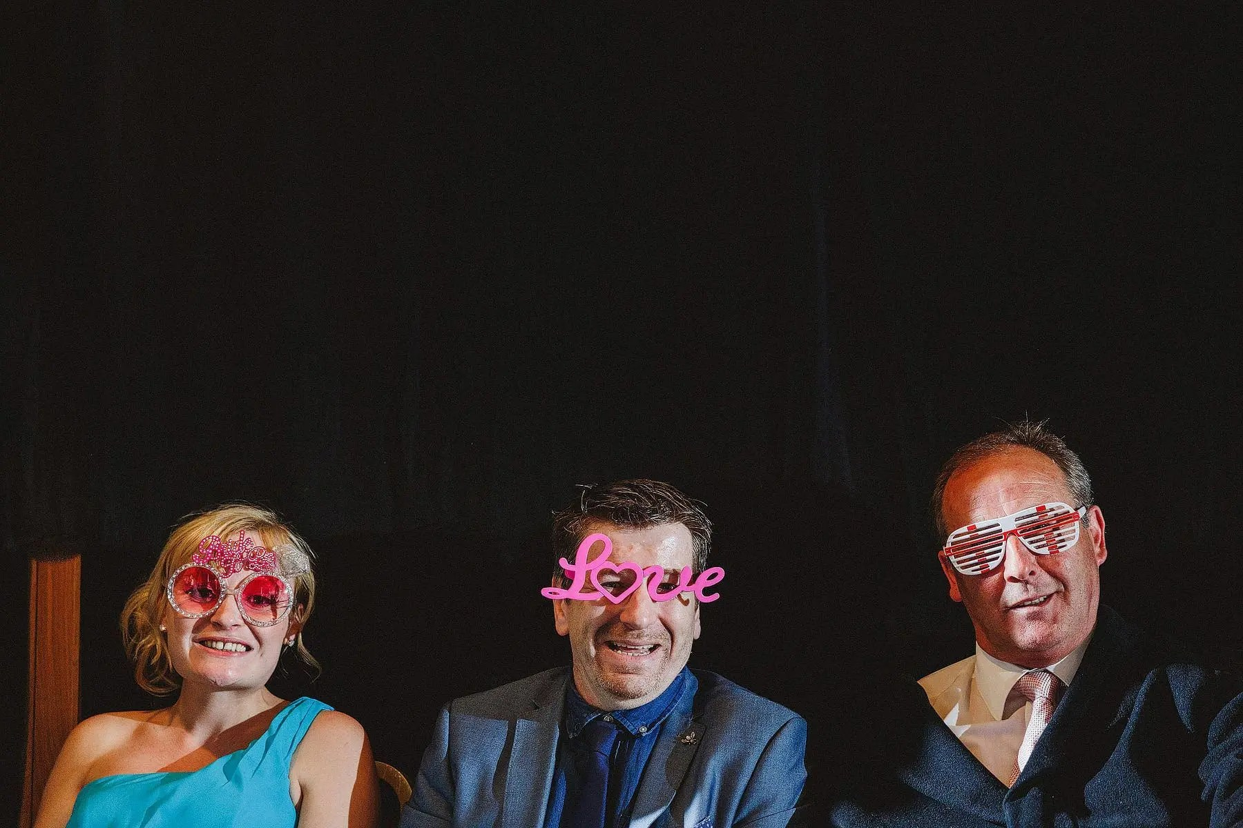 wedding guests in funny glasses
