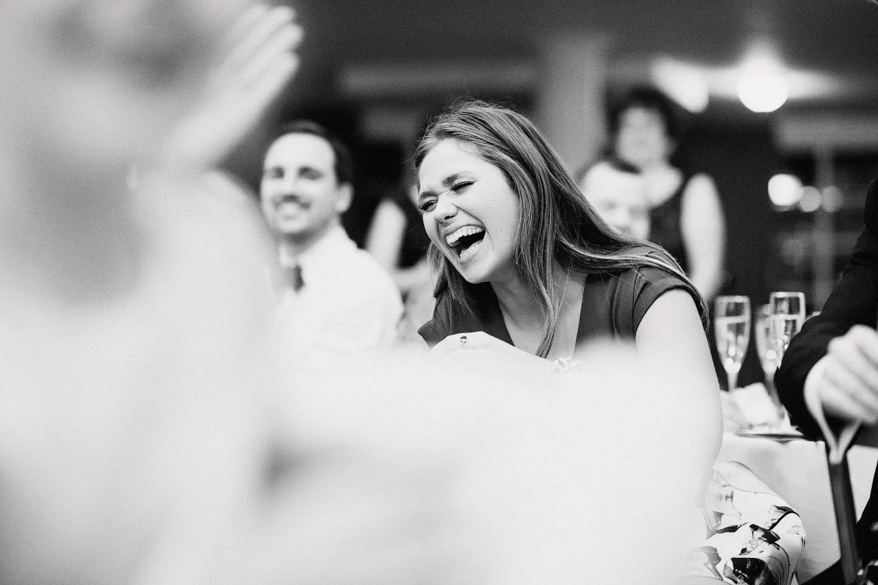 laughing at wedding speech
