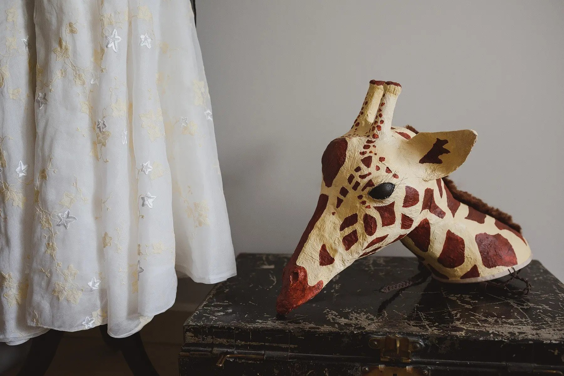 giraffe mask at a wedding