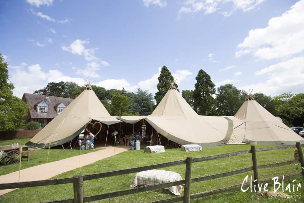 Two giant hat tipis and Chill-Out Tipi - Sami Tipi Wedding captured by Clive Blair
