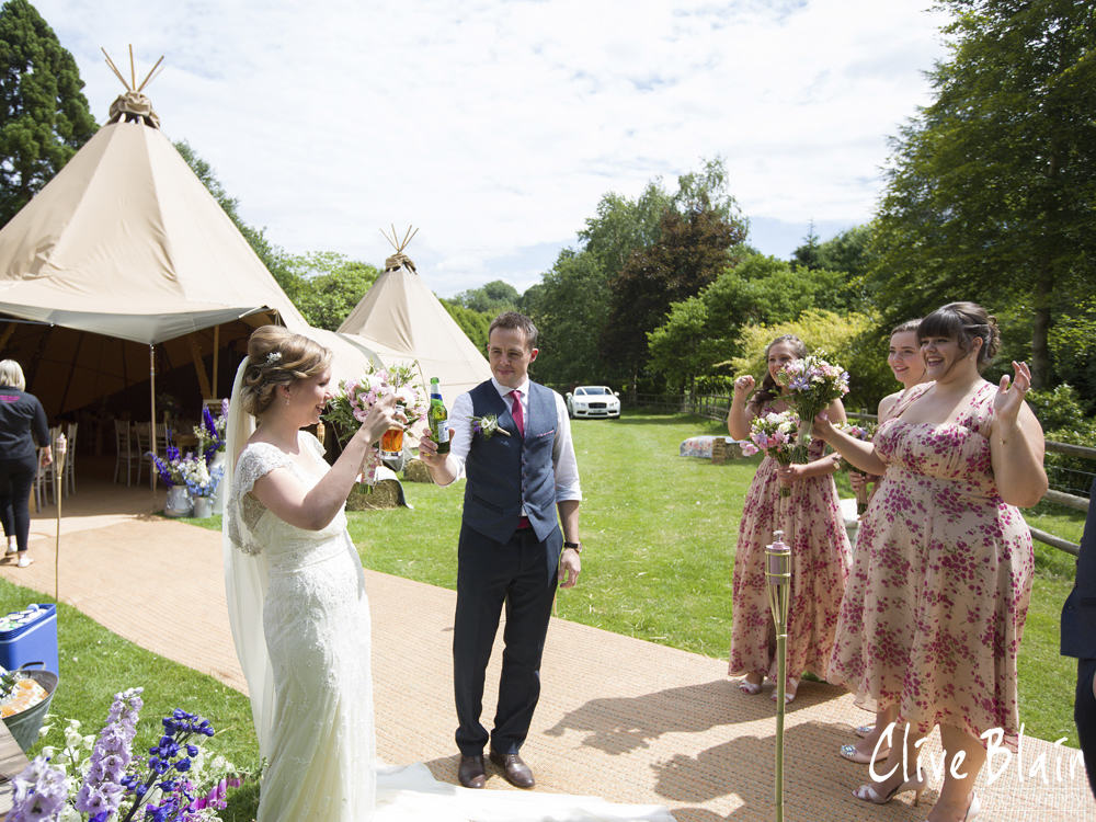 Outdoor ceremony- Sami Tipi Wedding captured by Clive Blair