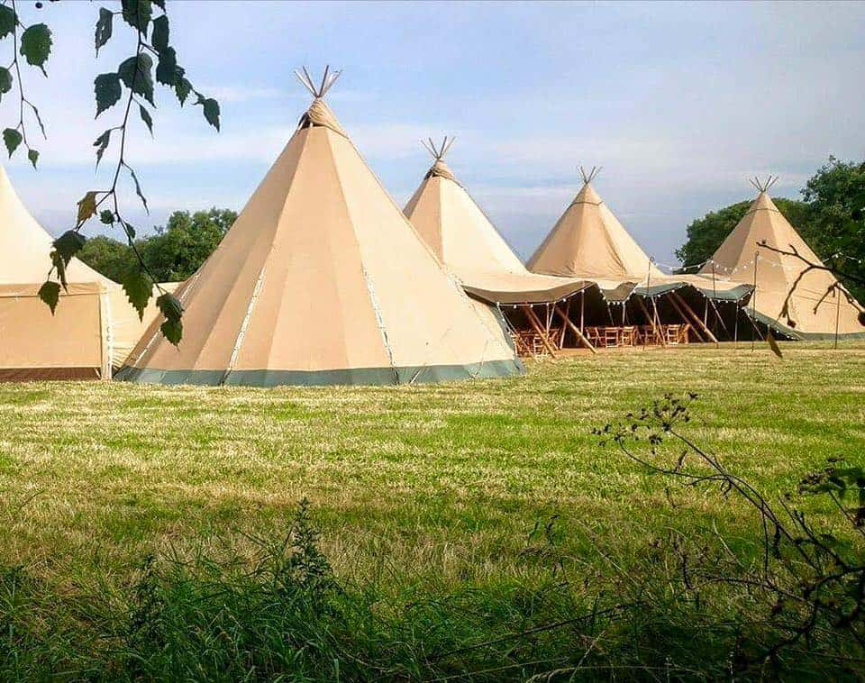 4-giant-hat-tipis-in-an-arc-by-sami-tipi