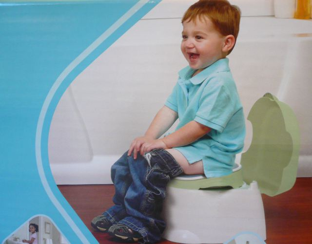 Kid on Side of Potty Chair Box Way Too Excited to Be Taking a Sh*t