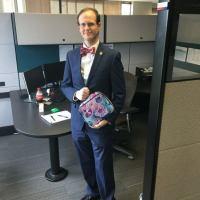 man brings cat lunchbox to work, bullied teen