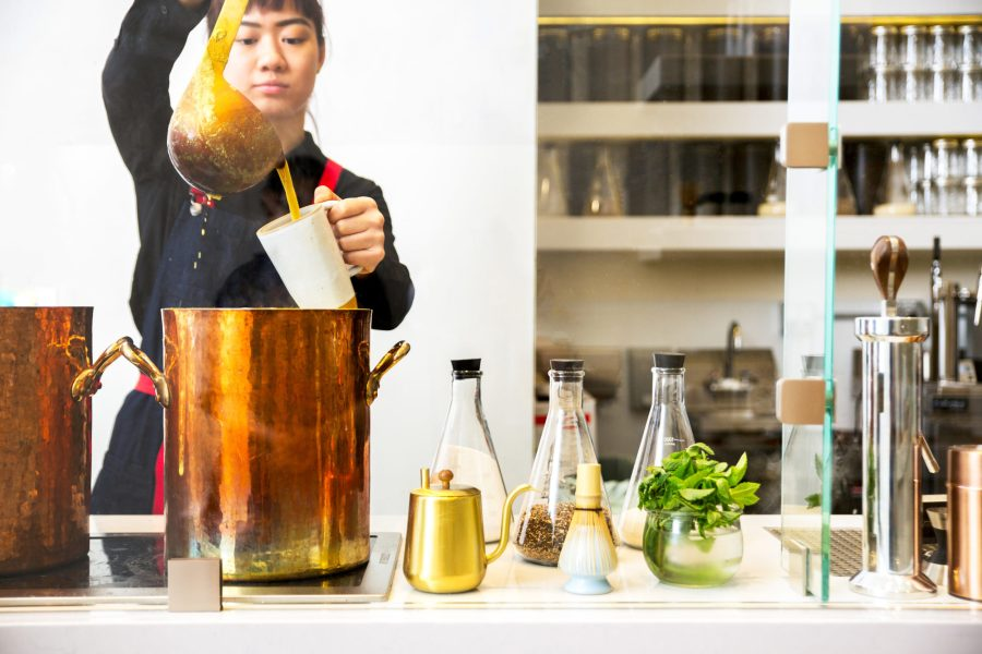 Chai is brewed and served from a copper kettle