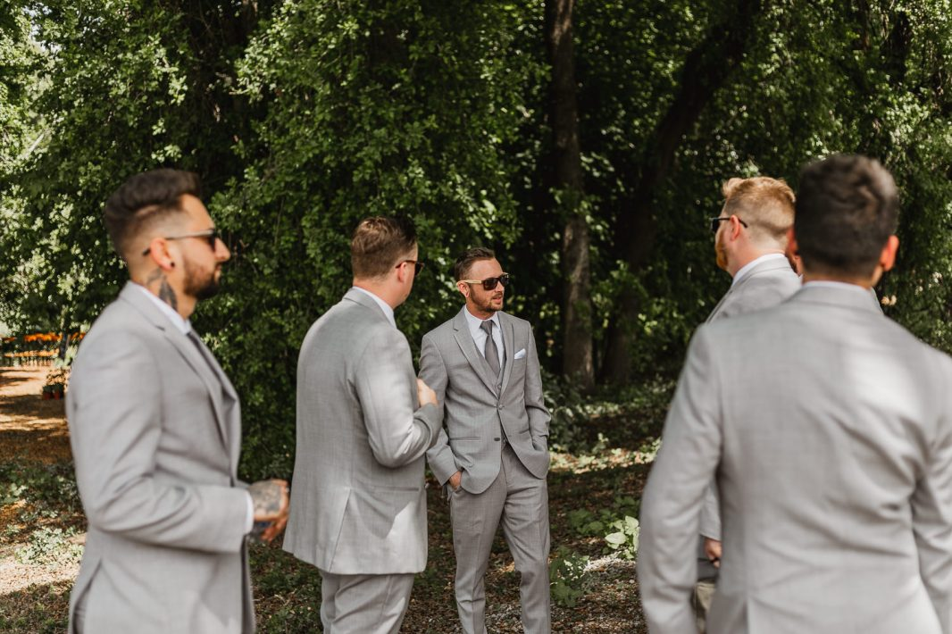 Groom and groomsmen photos at gorgeous outdoor wedding.