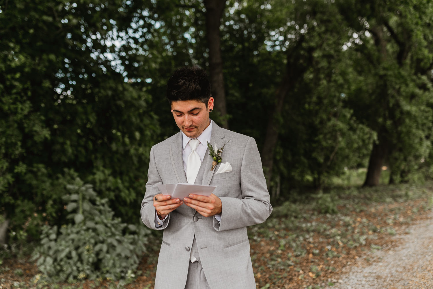 Groom reading love letter from wife to be.