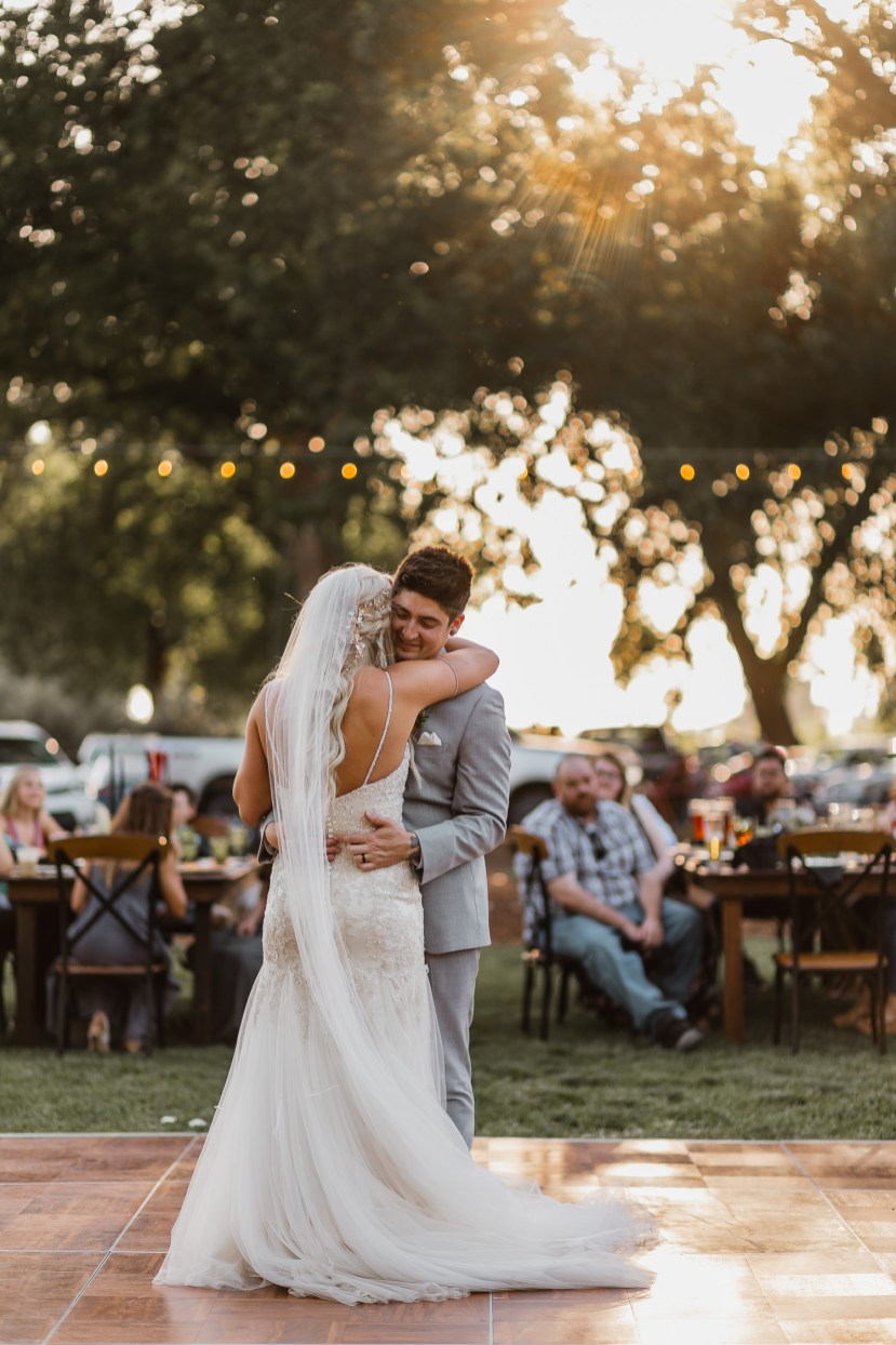 Bride and Groom first dance during sunset.