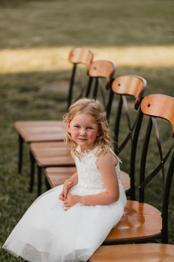 Adorable flower girl smiling for the camera.