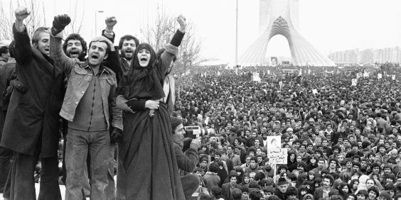 Demonstrators in Shahyad Square, Tehran, during the 1979 Revolution. Image via: Wikimedia Commons.