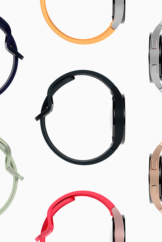 The sideways view of different Galaxy Watch4 devices are placed next to each other, forming a pattern. Various body and band colors are shown, from olive green, mustard, navy, pink, red and silver.