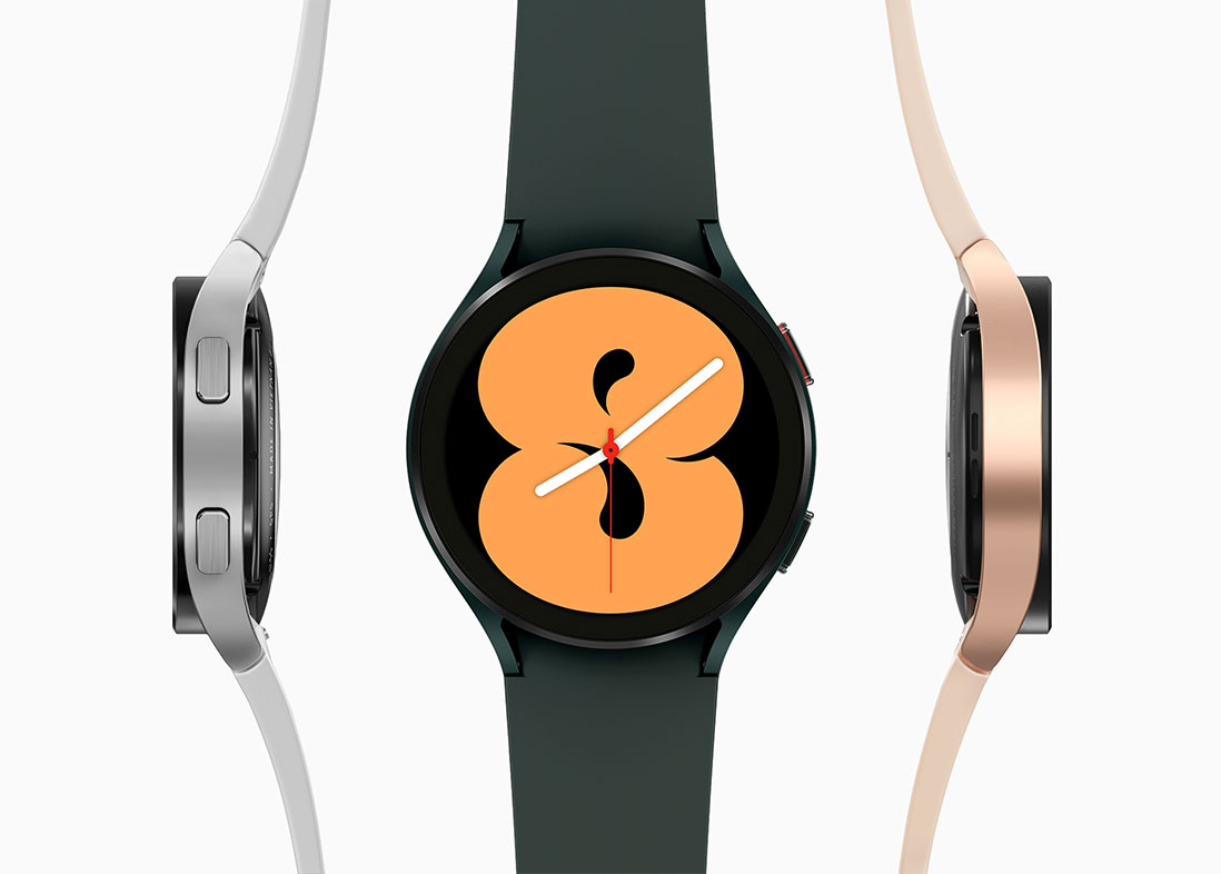 There are three Galaxy Watch4 devices. The middle is in a green color and is showing its front watch face that has the number eight displayed. On th left is a silver Galaxy Watch4 showing the button side. On the right is a pink gold Galaxy Watch4 showing the opposite side.