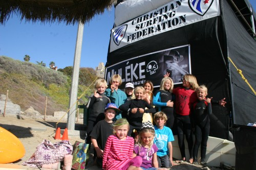 A group of local youngsters gather for a group shot between heats at the Soul CSF Family Surf contest, March 9 at T Street in San Clemente: Photo by Andrea Swayne