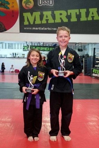 Kylie Marcisz (left) and Grant Foster, both students at United Studios of Self Defense dojo in San Clemente, were honored by the Capistrano Unified Council of PTSA as part of a national PTA program. Photo: Courtesy