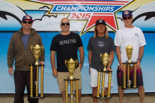 Surfing America USA Championship Legends 50+ Shortboard finalists (L to R) 1. Tom Matthews, San Diego; 2. Masaki Kobayashi, San Clemente; 3. Rusty Phillipy, Cardiff and 4. Troy Campbell, Torrance, gather for a podium shot. Photo: Surfing America/Jack McDaniel