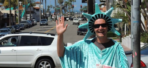A living mascot with Liberty Tax Service in San Clemente waves at passersby in Statue of Liberty garb in this April photo. The city of San Clemente is looking to amend a zoning ordinance what would prohibit this kind of advertising on public right-of-way. Photo: Courtesy Liberty Tax Service in San Clemente