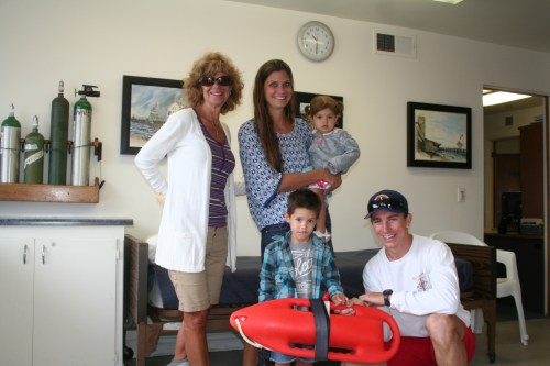 Linda McKay, Erika Pinon and her two children, Berlin and Bronson, pose for a photo during their tour with lifeguard David Coy. Photo: Jacob Onofrio