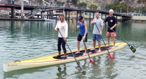 (L to R): Barrie Boehne, Gloria McLaughlin, Mac McLaughlin, Steve Boehne participate in stand up paddle boarding on Saturday.