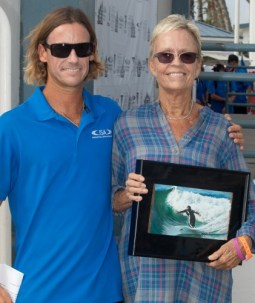 ISA World Junior Surfing Championship Contest Director Erik Krammer and 2015 Surfing America Midget Smith Judging Award recipient MaryLou Drummy pose for a photo after the award presentation, on the ISA World Juniors podium, Oct. 18, in Oceanside. Photo: Surfing America/Jack McDaniel