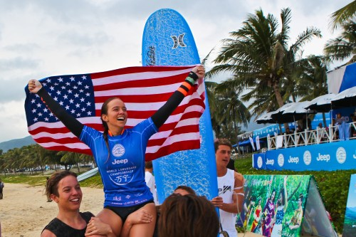 Rachael Tilly of Capistrano Beach is chaired up the beach Tuesday in China after winning the WSL 2015 Jeep Women's World Longboard Championship. Photo: WSL/Hain