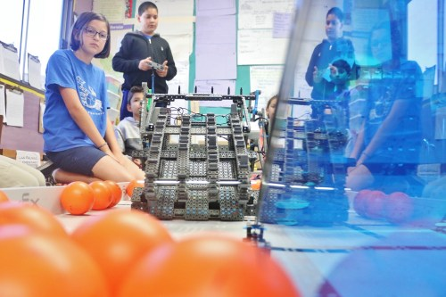 Estella Olivares, a fifth-grader at Las Palmas Elementary (left), and the VEX World Robotics team practice maneuvering a robot they will take to Louisville, Kentucky for the VEX World Championships for scholastic robotics competition in April. Photo: Eric Heinz