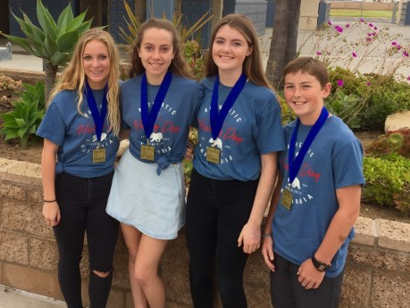 Shorecliffs Middle School students, from left, Kate McKernan, Kelly McDonald, Sophia Burick and Zane Pert pose with their National History Day medals. The four competed in the national competition in Washington, D.C. earlier this year. Photo: Courtesy