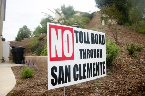 """""""No Toll Road Through San Clemente"""" signs such as this one on Costero Risco near The Reserve are seen throughout the city's residential and commercial properties. The Reserve homeowners association and the city of San Clemente both recently filed lawsuits against the Transportation Corridor Agencies regarding items related to toll road construction. Photo: Eric Heinz"""