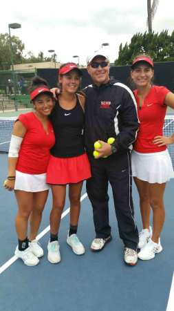 L to R: Jenna Yeam, Lindsay Hung, coach John Stephens and Sami Neilson celebrate the Triton tennis trios' sweep at the South Coast League finals tournament. Photo: Courtesy