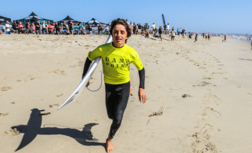 A young member of the Dana Point Surf Club runs to enter the water for his heat. The Dana Point Surf Club will host the West Coast Board Riders at Salt Creek on Saturday, April 7. Photo: Ron Lyon