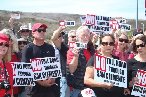 Dozens of people from San Clemente and surrounding cities came to support a press conference on a new State Assembly bill aimed to curtail The Toll Roads on Tuesday, May 8. Photo: Eric Heinz