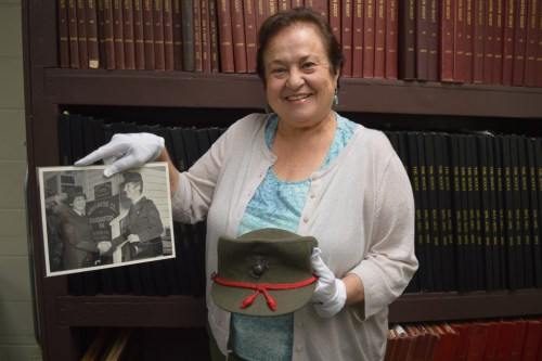 Faye Jonason, the director of the Camp Pendleton Museum, holds an undated photo of 1st Sgt. LaRue Ditmore, shaking hands with an unidentified captain at the Women Marine Company. Photo: Andrea Clemett