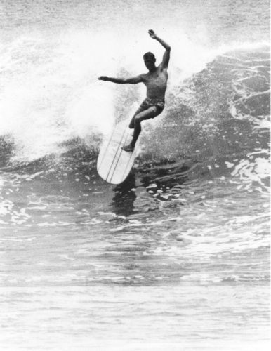 It was Phil Edwards' style and grace on a surfboard that set him apart from the pack during the 1950s and '60s. This classic cutback shot, a screen grab from a Bruce Brown film, served as the inspiration for the bronze sculpture that's being installed in Dana Point. Photo: Bruce Brown; Courtesy of Reyn Spooner