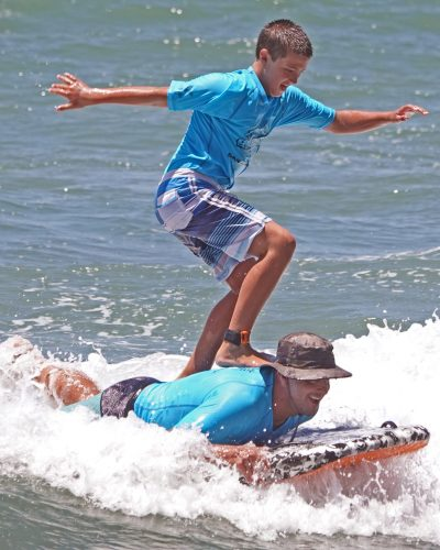 In tandem bodyboard competition, Conrad Rojas of San Clemente had his dad's back. Do note that Rob Rojas does appear to be smiling. Photo: Fred Swegles