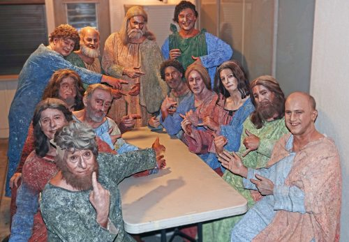 "Pageant of the Masters cast members point to San Clemente's Mark Brownell, seated second from left on the right side of the table, in a backstage reassembly of Leonardo da Vinci's masterpiece, ""The Last Supper."""
