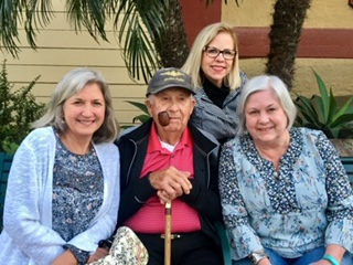 Davis pictured center with his three daughters. Photo: Courtesy of Davis family