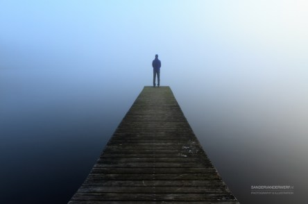 Looking over a lake into the mist
