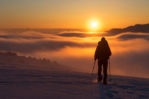 Hiking in the snowcovered Vercors during a colorful, winter sunset.