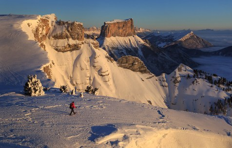 Walking in the snowcovered Vercors during sunrise.