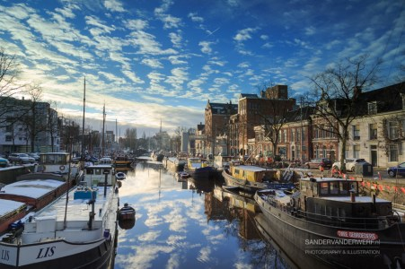 Ships and boats in a canal, Noorderhaven, on a cold day in winter.