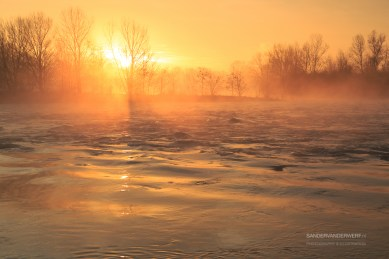 Tranquil and foggy sunrise at the Rhone river near Lyon.
