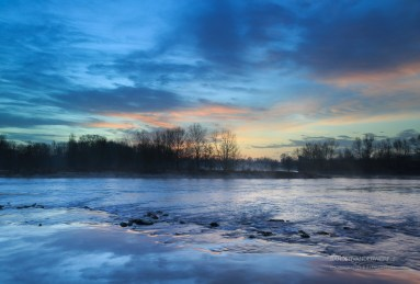 Tranquil and colorful sunrise at the Rhone river near Lyon.