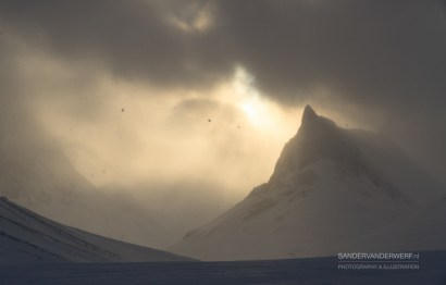 Clouds, snow and sun during winter in Lapland.