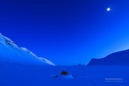 Tent in the snow during a cold night in the Swedish Arctic region.