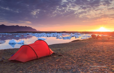 Red tent and sunset at the Jokulsarlon lake.
